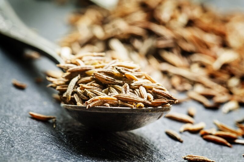zira-or-cumin-in-a-metal-spoon-on-a-dark-background-close-up-s-2