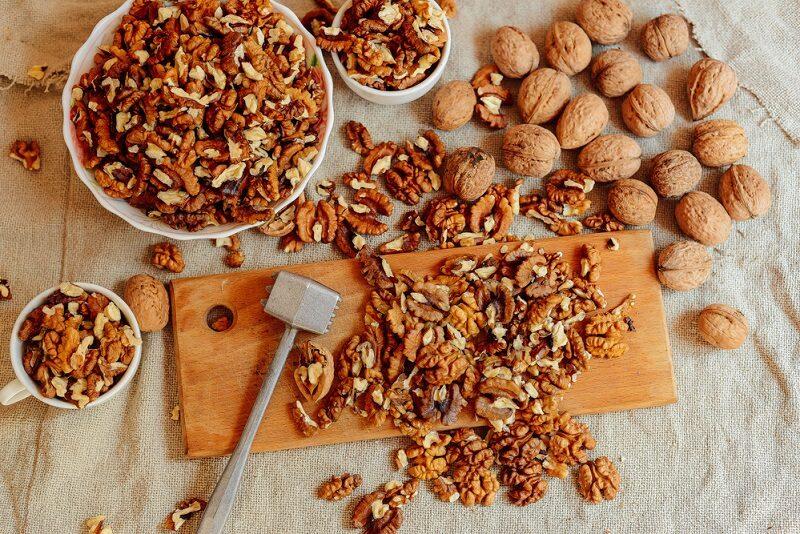 assortment-of-nuts-bowl-of-walnuts-on-wooden-texture-walnuts-a