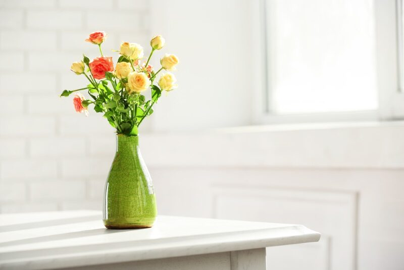 beautiful-spring-flowers-in-vase-on-window-background